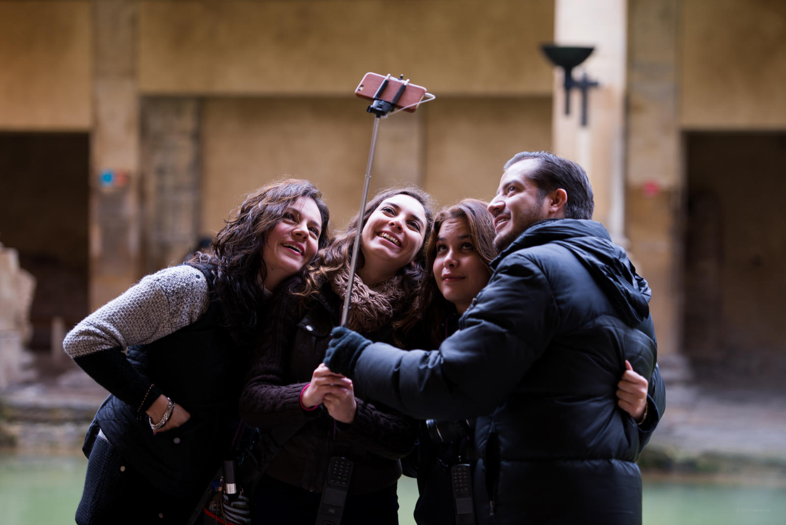 Image: Visitors taking a selfie at the Roman Baths