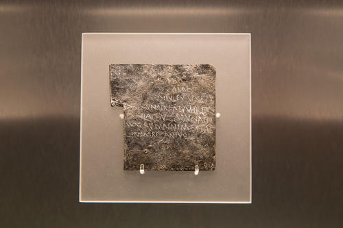 Image: Curse tablet on display in the museum