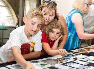 Image: Family looking at Roman coins