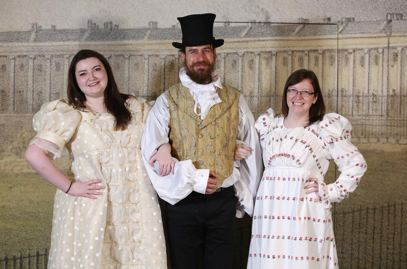 Image: Visitors dressing up at the Fashion Museum