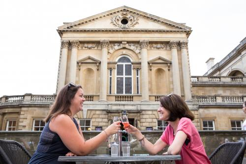 Image: Women sitting in the alfresco area at the Roman Baths Kitchen