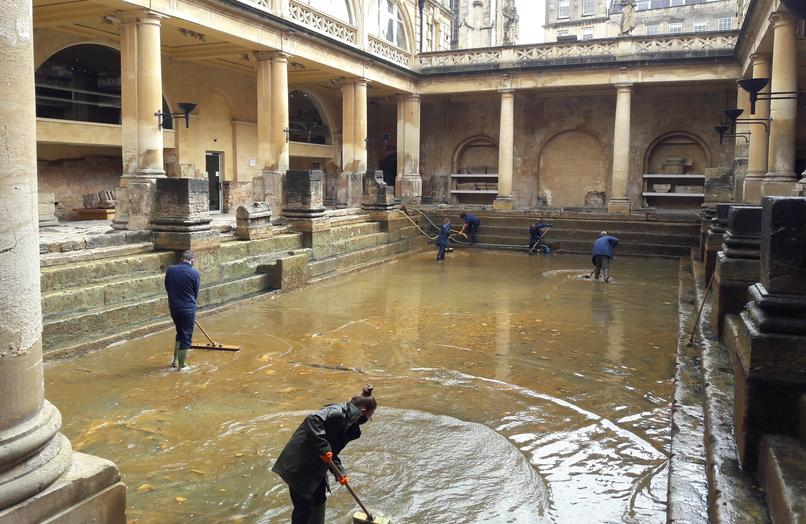 Image: Operations staff cleaning the Great Bath