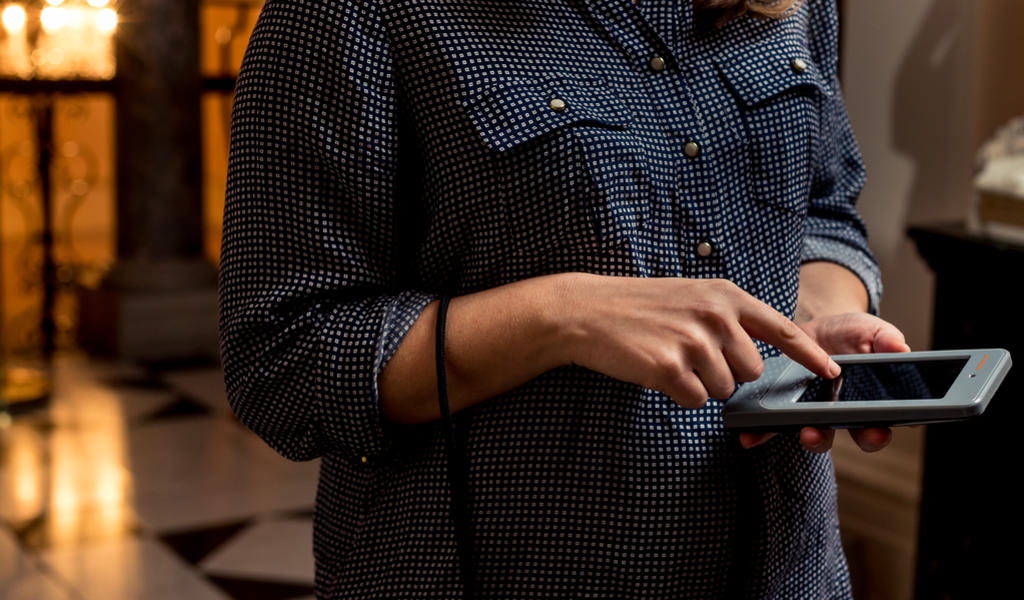 Image: A visitor using an electronic device