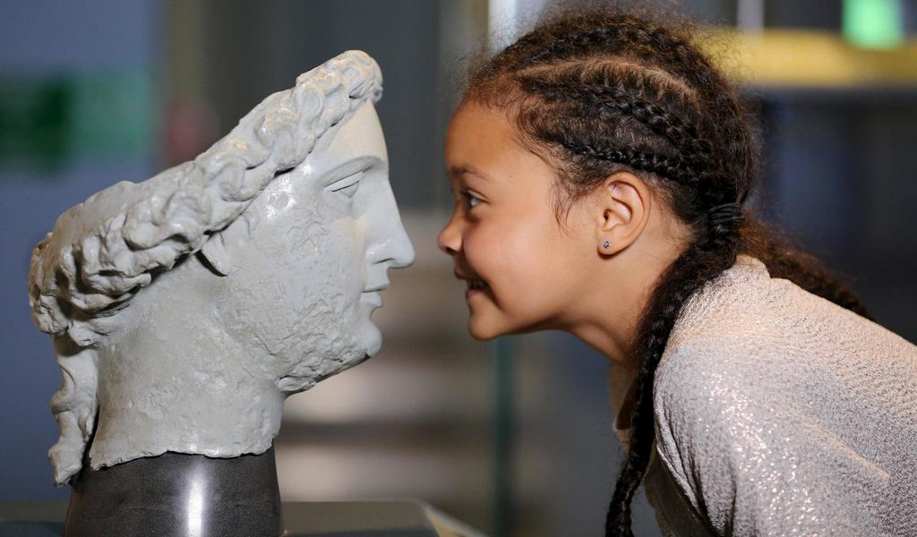 Image: A girl looking at a model in the museum