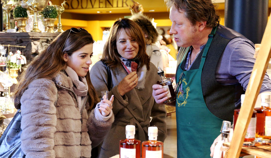 Image: Visitors trying products in the Roman Baths Shop