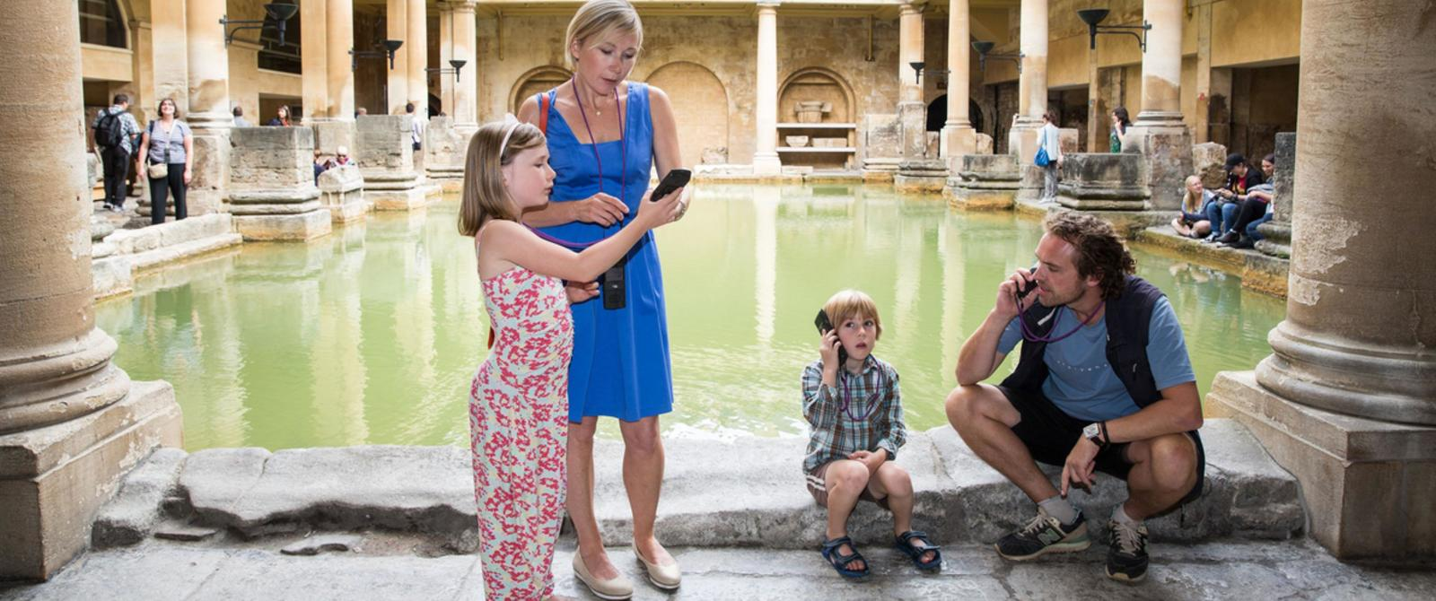 Image: Family using audioguides
