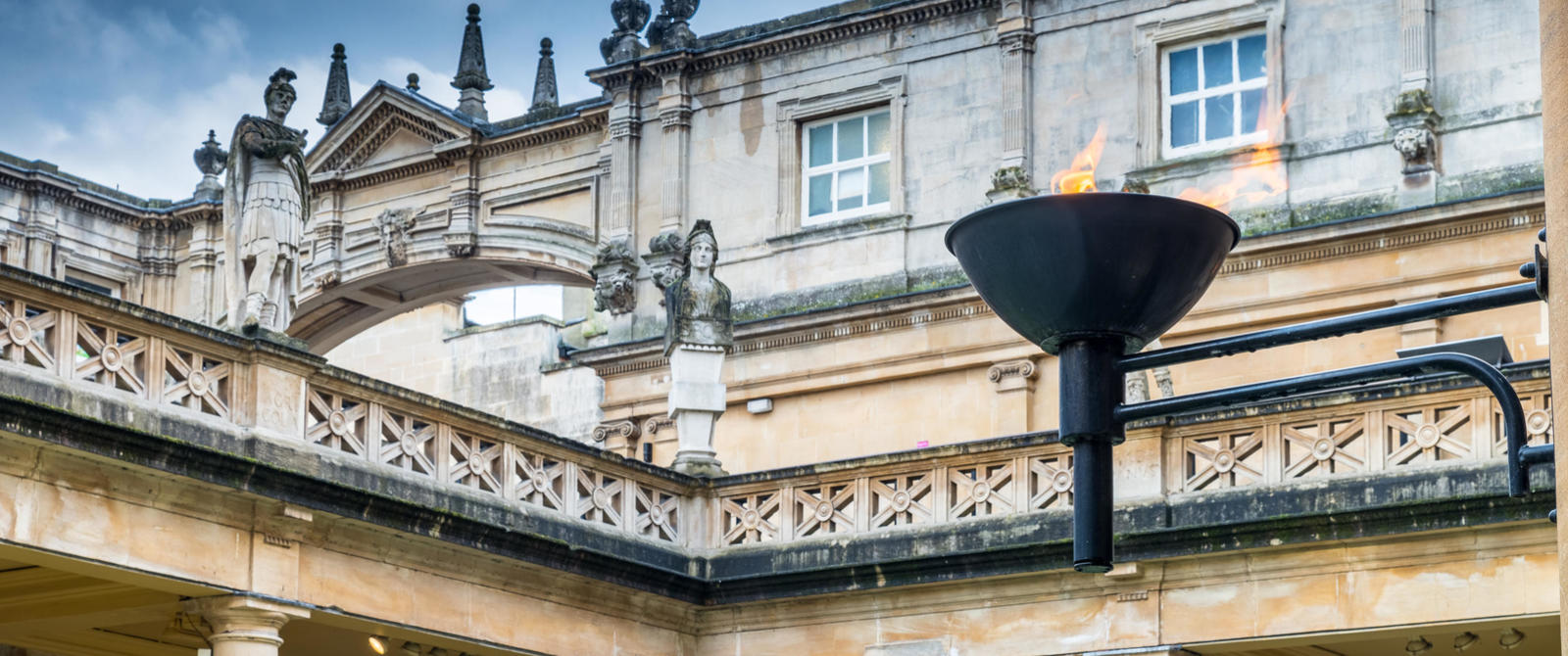 Image: Torch beside the Great Bath