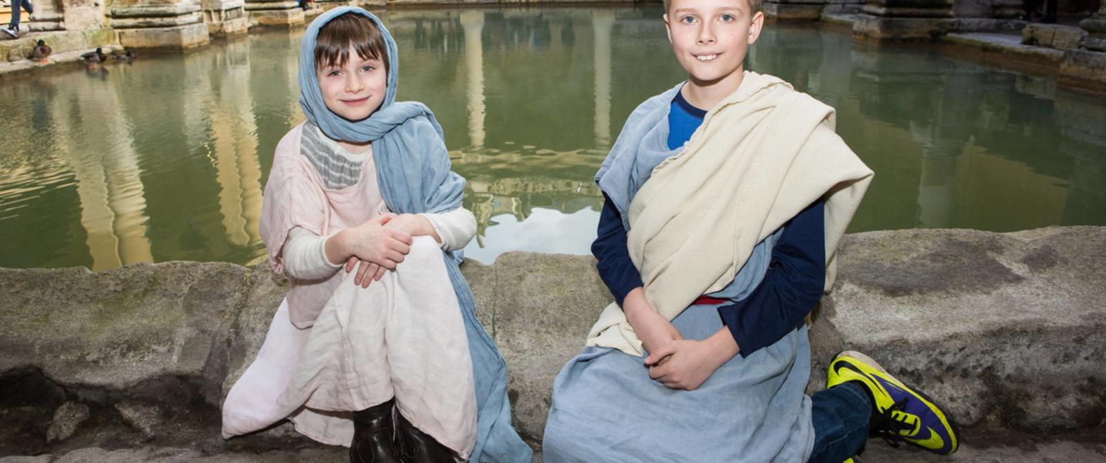 Image: children dressed up at the Roman Baths