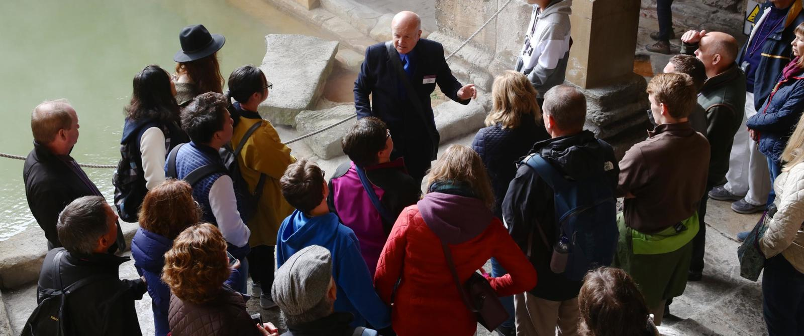 Image: A group taking part in a guided tour