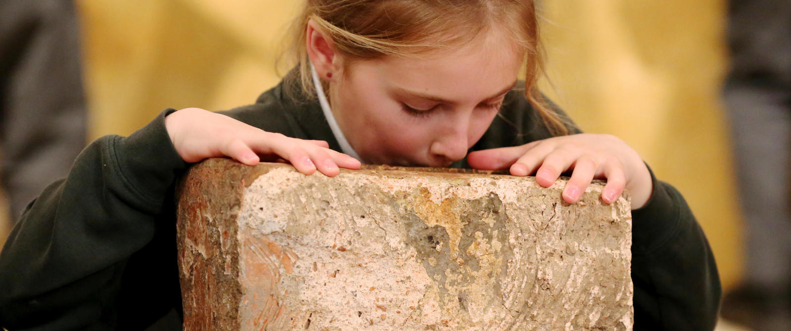 Image: Girl with a Roman stone