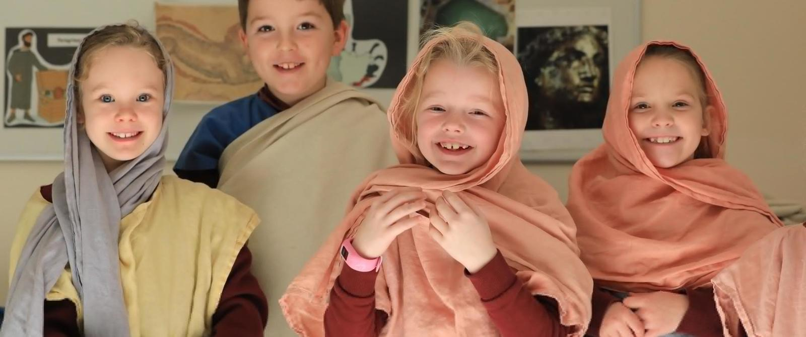 Image: Children dressed up in togas