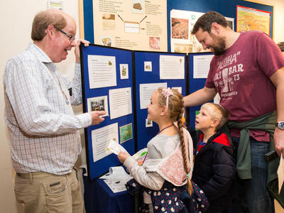 Image: A family learning about the Roman Baths