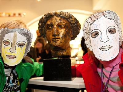 Image: Children with Minerva masks