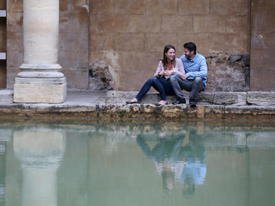 Image: A couple beside the Great Bath in the evening