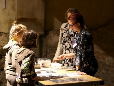 Image: Children looking at artefacts beside the Great Bath
