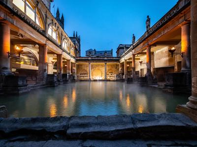 Image: The torchlit Great Bath
