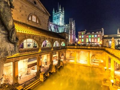 Image: The Roman Baths lit by torchlight