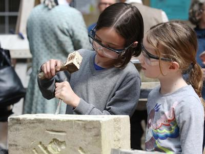 Image: Two children stone carving