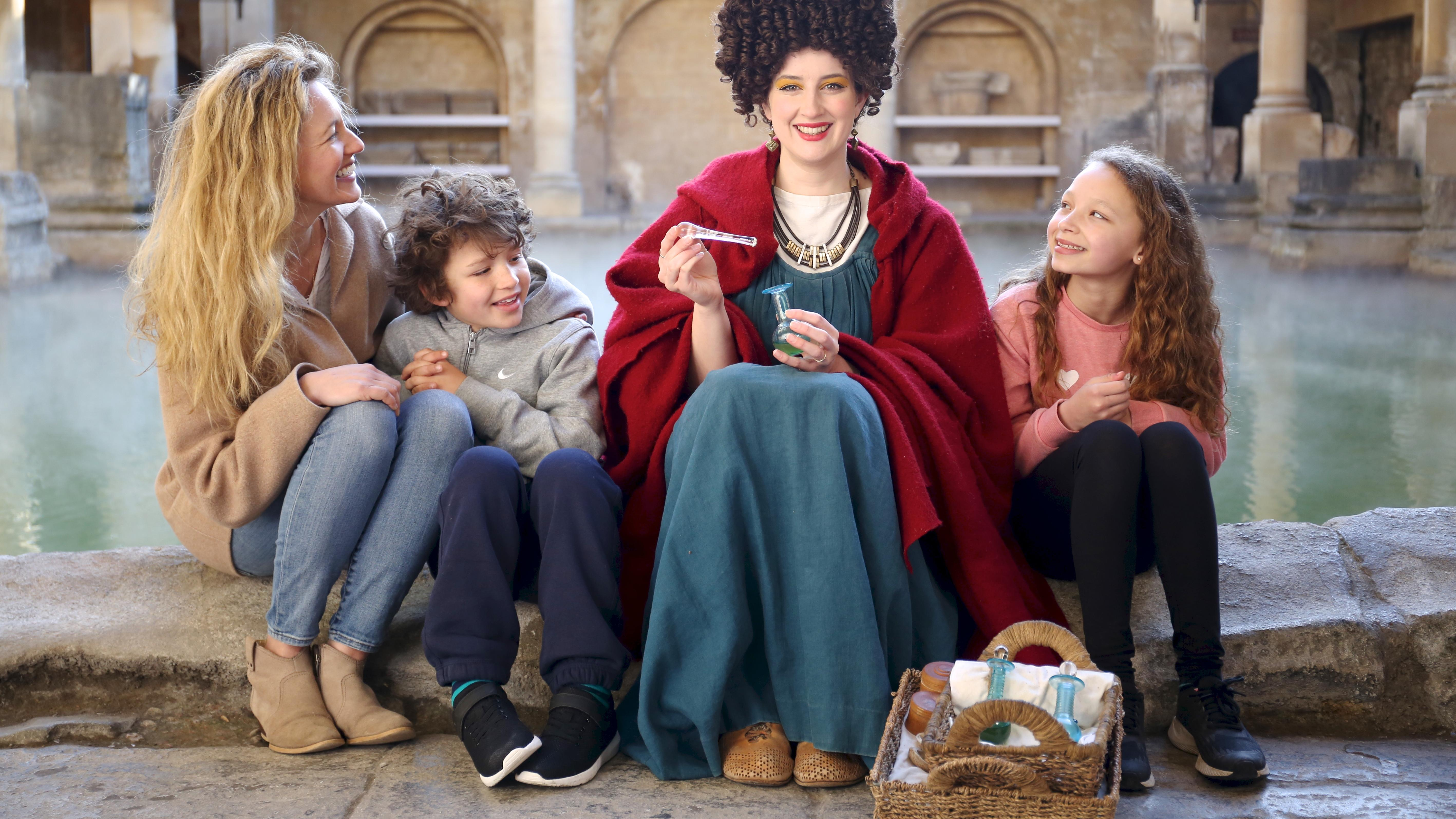 Image: A family interacting with a costumed character