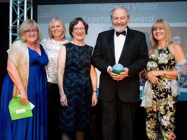 Image: The Roman Baths team with one of their awards