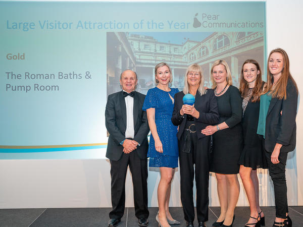 Image: Roman Baths staff collecting a Gold award