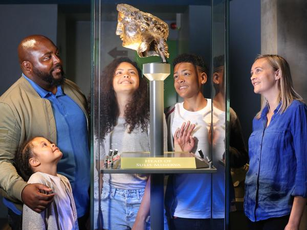 Image: A family looking at Minerva's head
