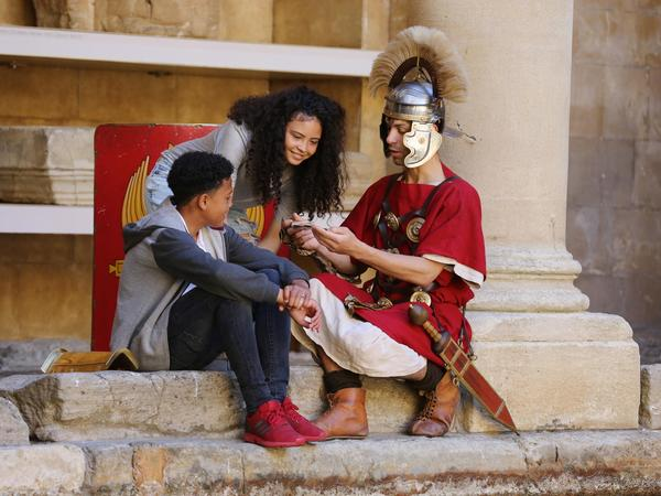 Image: Children meeting a Roman soldier