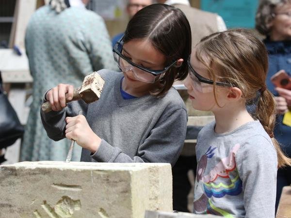 Image: Children having a go at stone carving