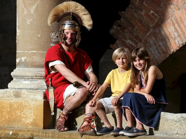 Image: Roman soldier and children beside the Great Bath
