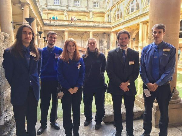 Image: Past and present apprentices beside the Great Bath