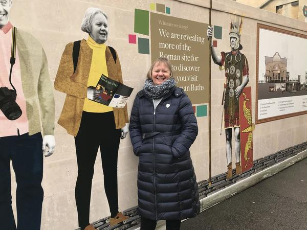 Image: Joy beside her picture on the hoardings