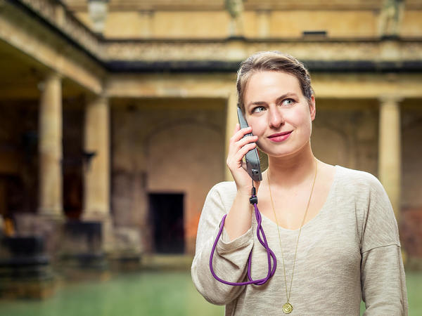 Image: Visitor listening to an audioguide