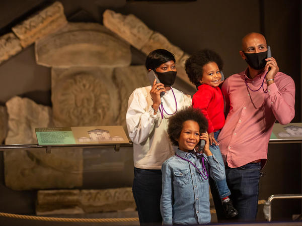 Image: A family visiting the Roman Baths