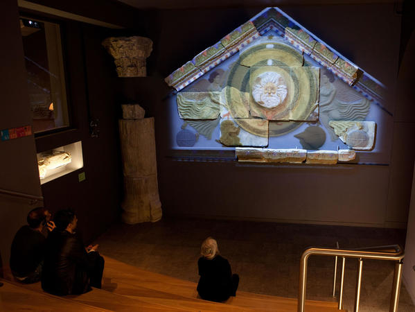 Image: Visitors learning about the Temple Pediment