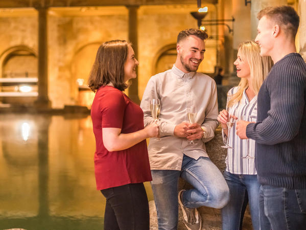 Image: Visitors enjoying a drink beside the Great Bath