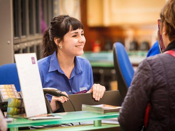 Image: Visitor Services Assistant at reception